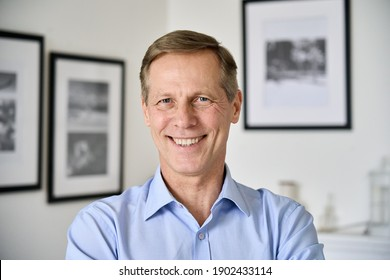 Smiling handsome middle aged 50s single man looking at camera standing at home, happy satisfied confident senior mature european male model posing indoors for close up face headshot portrait. - Shutterstock ID 1902433114