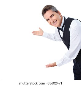 Smiling handsome waiter. Isolated over white background.