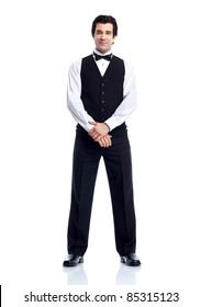 Smiling handsome waiter. Isolated over white background.