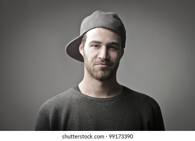 Smiling handsome young man wearing a peaked cap