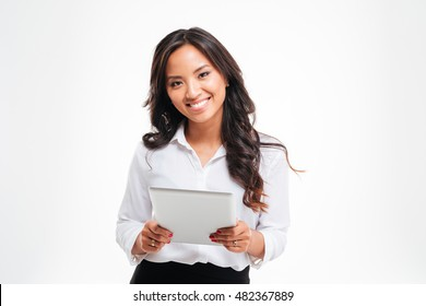 Smiling happpy asian businesswoman holding tablet computer isolated on a white background