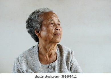Smiling of happy Asian elderly senior on white background, Lifestyle of Asian old women concept