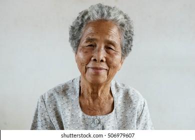 Smiling of happy Asian elderly senior on white background
