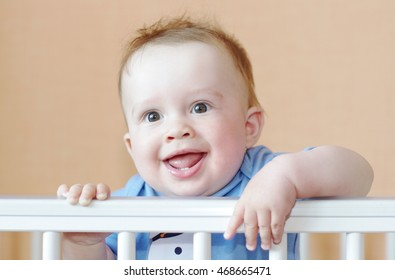 smiling happy baby in white bed