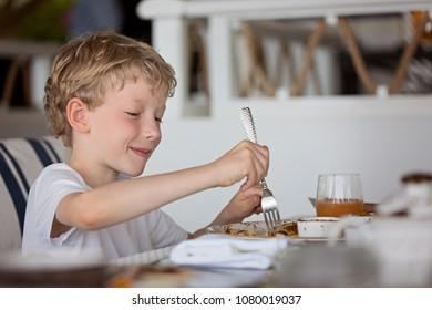 smiling happy boy enjoying breakfast