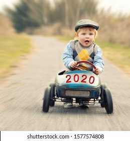 smiling happy boy ride his car in the new year 2020 - start new year