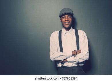 Smiling happy dark skinned stylish male