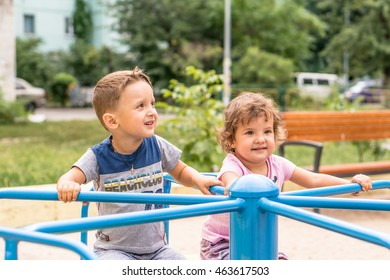 Smiling happy little babies, boy and girl spending time in the park. Funny cute child making vacations and enjoying summer. Positive human emotions, feelings, joy.