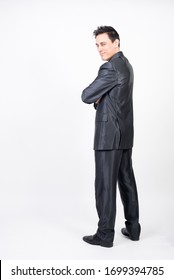 Smiling and happy man in suit. White background, full body