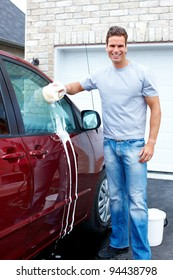 Smiling Happy man washing the car.