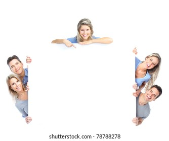 Smiling happy people with big poster. Isolated over white background.