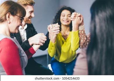 Smiling and happy people during group therapy. Overcame drug addiction. Toned concept.