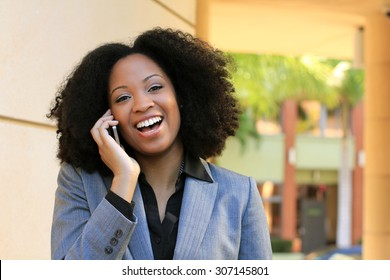 Smiling and Happy Professional African American Business Woman College Student With Black Hair Talking on the Phone