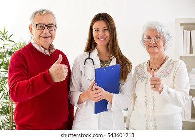 Smiling and happy senior couple with doctor at clinic, close up