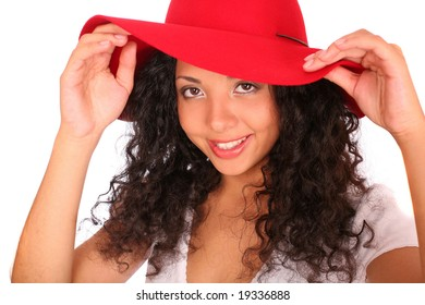 A smiling, happy woman in red hat stands on white background.