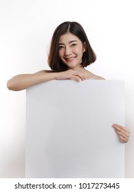 smiling happy  young Asian woman   with big white poster on isolated background