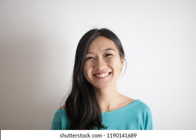 Smiling happy young Asian woman