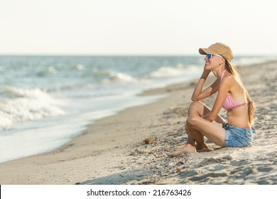 Smiling happy young woman enjoying serene ocean nature during travel holidays vacation outdoors