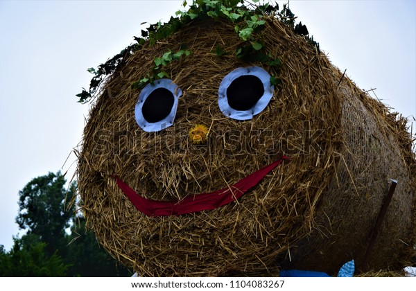 smiling haystack with eyes and mouth