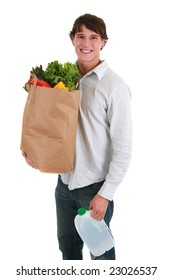 Smiling Healthy Looking Young Man Holding Groceries Paper and Water Bottle Bag Isolated