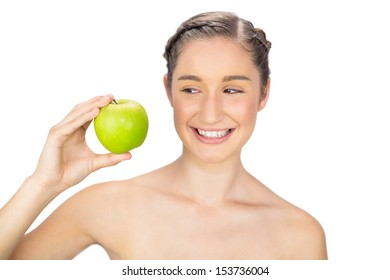 Smiling healthy model holding green apple on white background