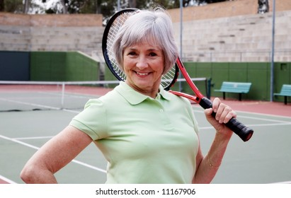 Smiling and Healthy Senior on the Tennis Court.