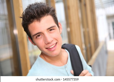 Smiling high-school boy with backpack