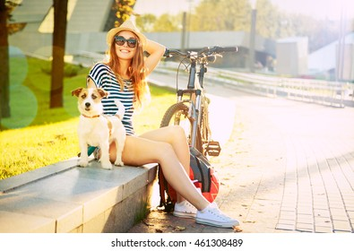 Smiling Hipster Girl with her Dog in Summer City