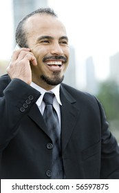 Smiling Hispanic business man on Phone