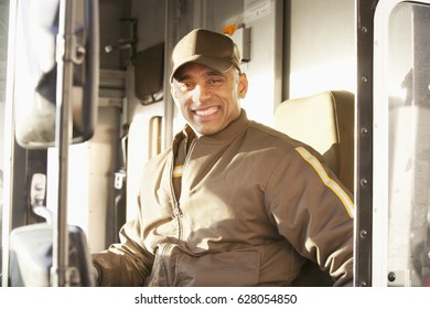 Smiling Hispanic delivery man sitting in truck