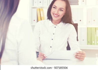 Smiling HR department employee is interviewing prospect candidate for an important opening in the company. Toned image