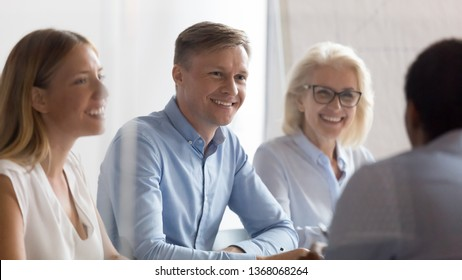 Smiling hr group looking at candidate talking at job interview, professional recruiting managers team make good first impression listen vacancy applicant introduction at hiring business negotiations