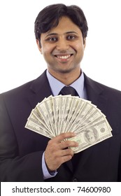 Smiling Indian business man holding handful of money isolated over white