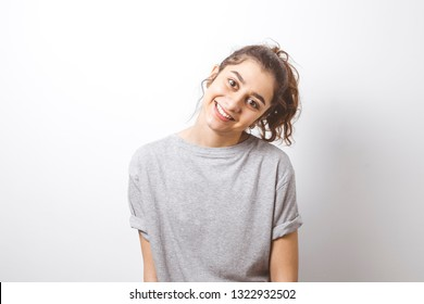 Smiling Indian girl on white background.