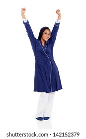 smiling indian woman in pajamas stretching in the morning isolated on white background