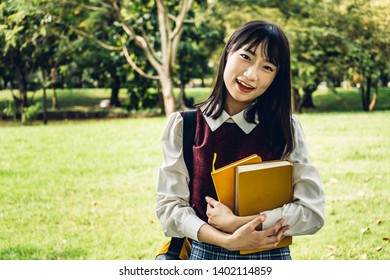 Smiling international students or teenagers standing  in park at university.Education concept