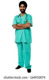 Smiling isolated male doctor, arms crossed