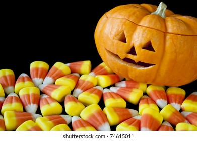 Smiling jack-o-lantern surrounded by candy corn