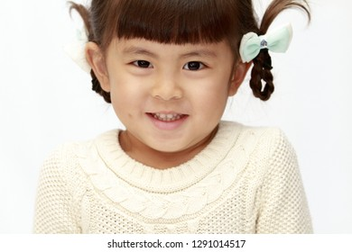 smiling Japanese girl (4 years old) (white back)