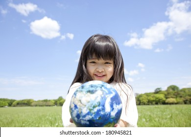 Smiling Japanese girl with a globe