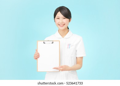 smiling Japanese nurse with Bulletin Board
