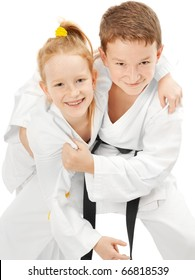 Smiling karate boy and girl, isolated on white