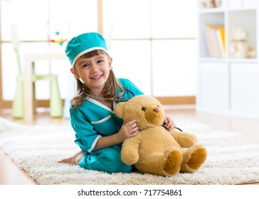 Smiling kid girl pretending she is a doctor in hospital