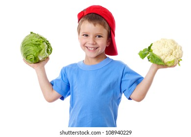 Smiling kid in red hat with cabbage and cauliflower, isolated on white