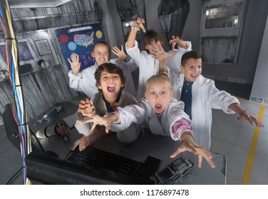 Smiling kids are concentrating on finding a way out of bunker quest room