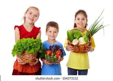 Smiling kids with fresh vegetables in hands, isolated on white