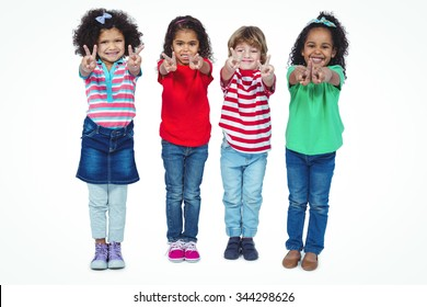 Smiling kids holding up fingers making peace signs against a white background