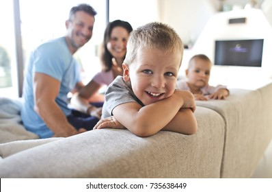 Smiling kids with their parents in the living room