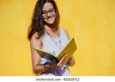 smiling lady with book in her hands
