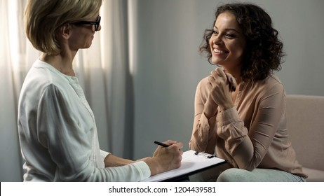 Smiling lady patient thanking her psychologist after depression rehab, therapy